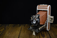 German made vintage camera on wooden board and black background Stock Photos