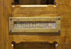 German mails slot in wooden door Stock Image