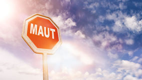 German Maut for road charges on red traffic road stop sign stock photo