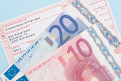 German medical prescription with euro notes. German medical prescription with various euro notes Royalty Free Stock Images