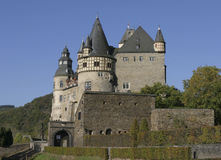 German medieval castle. Medieval castle in Germany standing in the bright sunlight of a clear autumn day stock photos