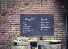 German menu of dishes on the board in the cafe outdoors Royalty Free Stock Photo