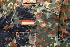 German military camouflage with flag patch Stock Photography