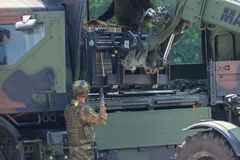 German military forklift FUG 4,0 Manitou lifts a pallet. BURG / GERMANY - JUNE 25, 2016: german military forklift FUG 4,0 Manitou lifts a pallet at open day in Royalty Free Stock Image