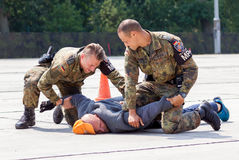 German military police bodyguards defeats an assassin. BURG / GERMANY - JUNE 25, 2016: german military police bodyguards defeats an assassin on an exercise in Royalty Free Stock Photography