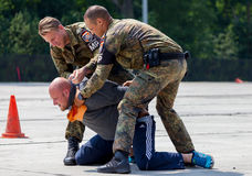 German military police bodyguards defeats an assassin. BURG / GERMANY - JUNE 25, 2016: german military police bodyguards defeats an assassin on an exercise in Stock Image