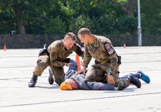 German military police bodyguards defeats an assassin. BURG / GERMANY - JUNE 25, 2016: german military police bodyguards defeats an assassin on an exercise in Royalty Free Stock Photos