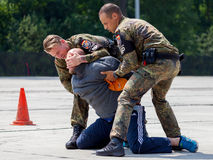German military police bodyguards defeats an assassin. BURG / GERMANY - JUNE 25, 2016: german military police bodyguards defeats an assassin on an exercise in Royalty Free Stock Image