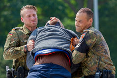 German military police bodyguards defeats an assassin. BURG / GERMANY - JUNE 25, 2016: german military police bodyguards defeats an assassin on an exercise in Royalty Free Stock Photo