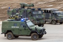 German military police soldiers defends an area against role playing demonstrators. MUNSTER / GERMANY - OCTOBER 9, 2017: german military police soldiers defends Royalty Free Stock Photo