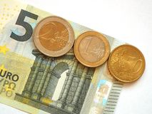 German minimum wage 8.50. The German minimum wage as 5 euro note and coins Stock Images