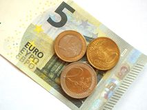 German minimum wage 8.50. The German minimum wage as 5 euro note and coins Stock Photos