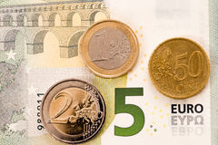 German minimum wage. A bill and several coins representing the german minimum wage Stock Photography