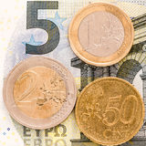 German minimum wage. A bill and several coins representing the german minimum wage Stock Images