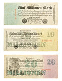 German money from hyperinflation. Three German banknotes from 1923, five Million, ten Million and twenty Million Mark Royalty Free Stock Photo