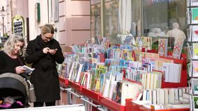 German mothers buying children books stock footage