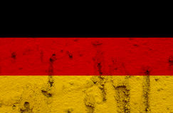 German National Flag On Grunge Wall Background. National  Flag of Germany on Abstract Grunge Wall Background Stock Photos