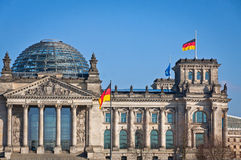 German National flag waving in front of German parliament buildi. Flag of Federal Republic of Germany waving in front of the German parliament building ( Stock Photo
