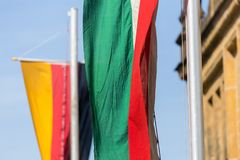 German and north rhine westphalia flags together. A german and a north rhine westphalia flags together royalty free stock photo