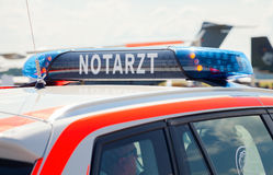 German Notarzt, emergency doctor car drives on airport Royalty Free Stock Photos