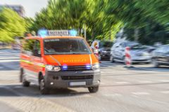 German Notarzt, emergency doctor car from fire department. Drives on a street to an accident stock image
