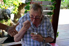 German old man eating ice cream Stock Image