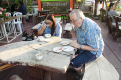 German old man and woman eating breakfast in morning time Stock Image