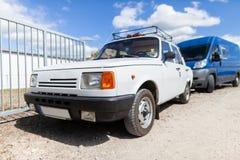 German oldtimer car stands on gravel road. White german oldtimer car stands on gravel road Stock Photos