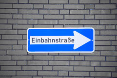 German One Way Road Sign on Brick Wall Royalty Free Stock Image