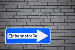 German One Way Road Sign on Brick Wall Royalty Free Stock Images