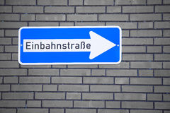 German One Way Traffic Sign on Brick Wall Stock Photography