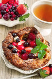 German pancake. Mini german pancake with mix of berries and tea. Selective focus Stock Image