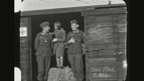 German Paramedic Soldiers And A Girl Joking On A Train. GERMANY,  BAVARIA, AUTUMN 1941. Two German Paramedic Soldiers With A Young Girl Standing On A Hay Bale stock video