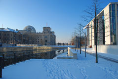 German parliament, Berlin. Winter view. The German parliament and government buildings in Berlin. Winter season: river Spree embankment under snow stock photo