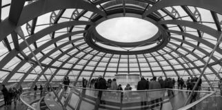 German Parliament, Berlin - Forms and turists. German Parliament inside. A masterpiece, like most German buildings. The image is represented by the dome, with royalty free stock photos