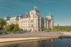 Reichstag German parliament building in sunset. German parliament building Reichstag in Berlin, hosting the Bundestag, in early monring sunset light Royalty Free Stock Photo