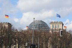 GERMAN PARLIAMENT BUILDING REICHTAG AND BUNDESTAG. Berlin /Germany . 05 March 2019. German and europeain nion flags fly over German bundestag or reichtag and royalty free stock images