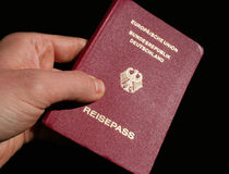 German Passport. Showing the German Passport in front of black background stock images