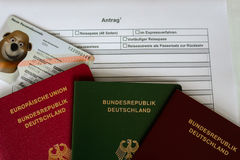German passport application form with passports  Stock Photos