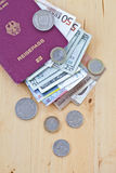 German passport and different currencies Royalty Free Stock Image
