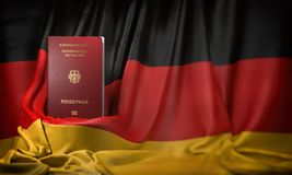 German passport on the flag of Germany. Getting a german passport,  naturalization and immigration concept. 3d illustration royalty free illustration