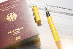 German Passport and petition for naturalizatio Stock Images