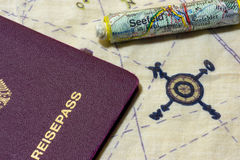 German passport and rolled up map on chart Stock Images