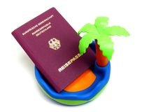 A German passport on a toy beach. Royalty Free Stock Photography