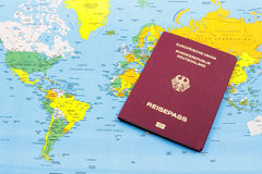 German Passport and world map Royalty Free Stock Image