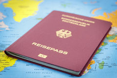 German Passport and world map Royalty Free Stock Photography