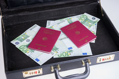 German passports with Euro bills in a briefcase Stock Photos