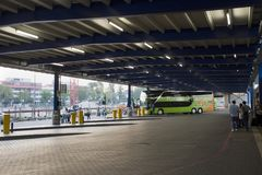German people and foreigner passengers wait and walk at Mannheim bus station Stock Photography