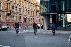 German people walking and biking bicycle on the road Stock Images