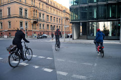 German people walking and biking bicycle on the road Stock Photography